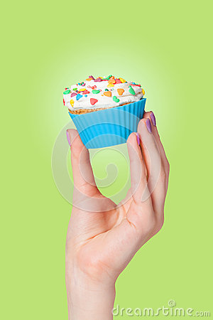 Hand holding cupcake