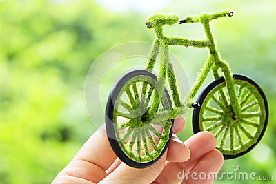 Hand Holding Eco bicycle icon concept