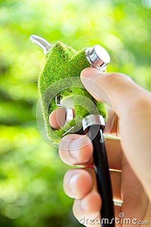 Hand holding eco fuel nozzle
