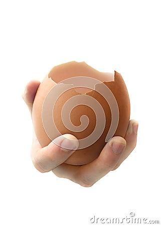 Hand holding egg shell