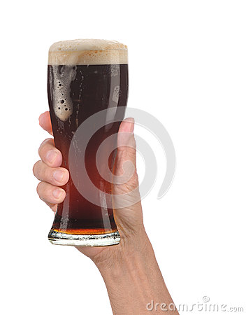 Hand Holding Glass of Foamy Beer