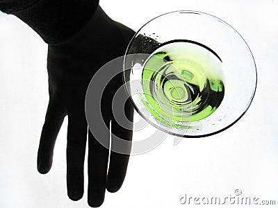 Hand holding glass of Martini Stock Photo