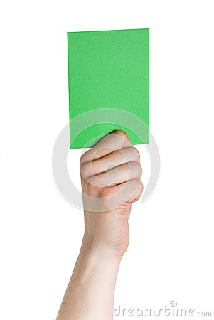 Hand holding a green tag