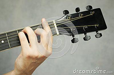 Hand holding guitar