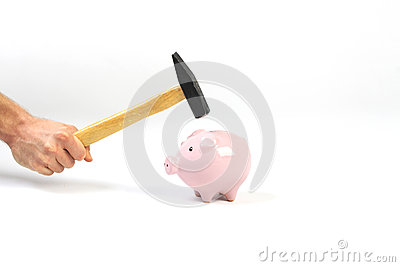 A hand holding a hammer which is raised above a standing pink piggy bank