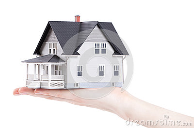 Hand holding house architectural model, isolated