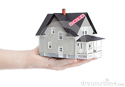 Hand holding household architectural model