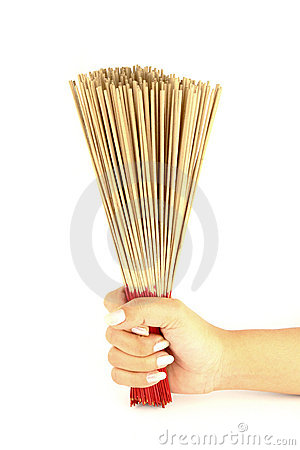 Hand holding incense