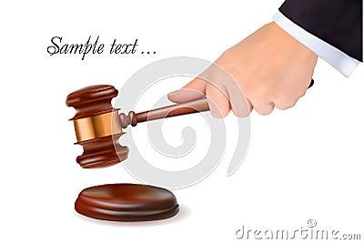 Hand holding judge gavel.
