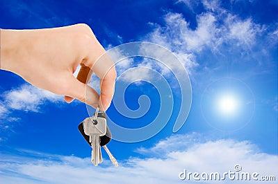 Hand holding keys.