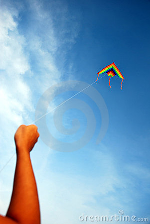 Hand holding a Kite