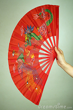 Hand holding large Chinese fan