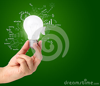 Hand holding light bulb with drawing charts and graphs