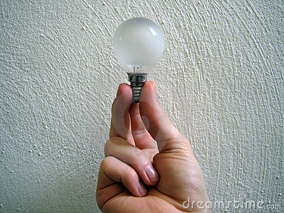 Hand holding lightbulb