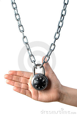 Hand holding locked chain