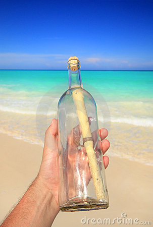 Hand holding message in a bottle