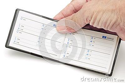 Hand holding mini address book