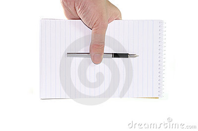 Hand holding a notepad and pen