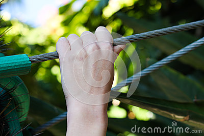 Hand holding onto a Wire cable
