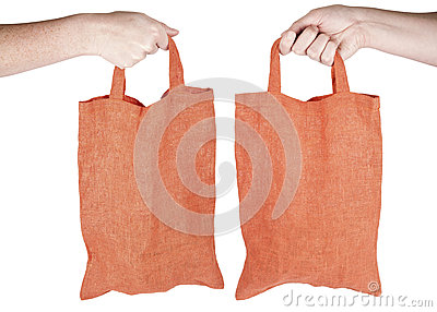 Hand holding orange fabric reusable shopping bag