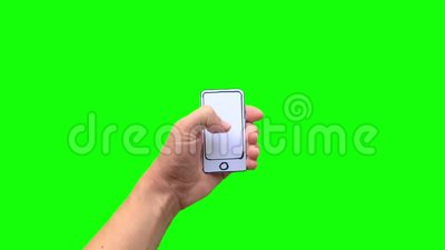 Hand holding paper mobile smart phone with blank screen. Isolated on green background stock footage