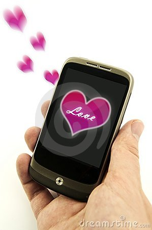 Hand holding phone with valentine love message
