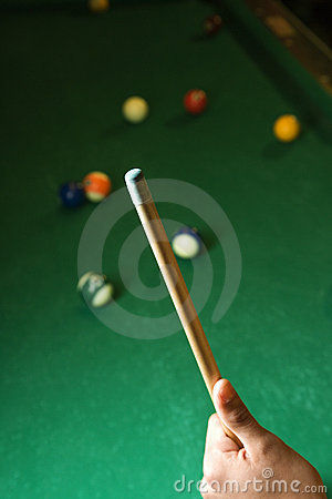 Hand Holding Pool Cue