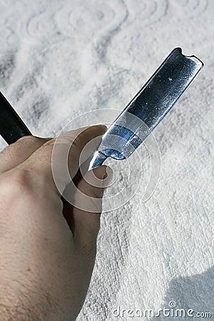 Hand holding razor