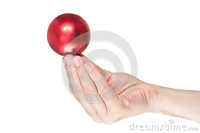 Hand holding a red christmas ball