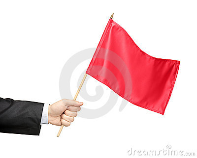 Hand holding a red flag