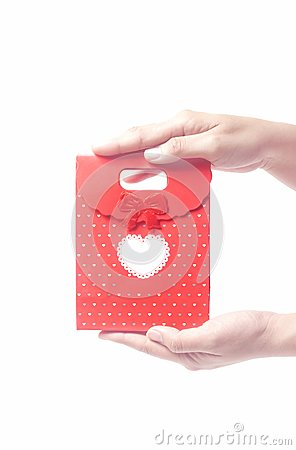Hand holding red gift bag