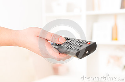 Hand holding remote controller