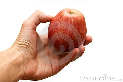 Hand holding ripe red apple
