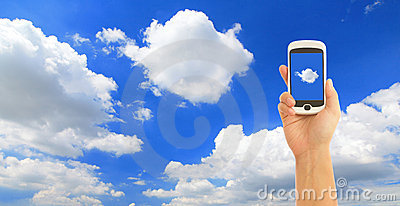 Hand holding smart phone with blue sky