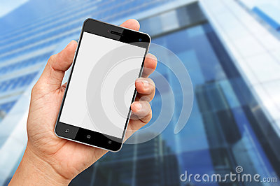 Hand holding smart phone with building background