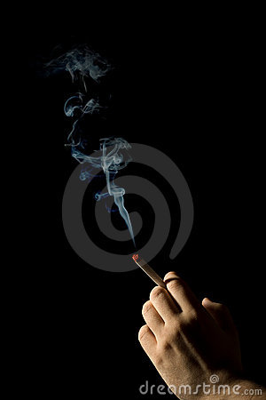 Hand holding a smoking cigarette isolated