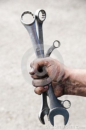 Free Hand Holding Spanners Royalty Free Stock Photo - 27547515