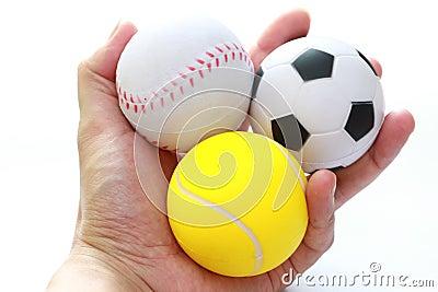Hand holding sport balls