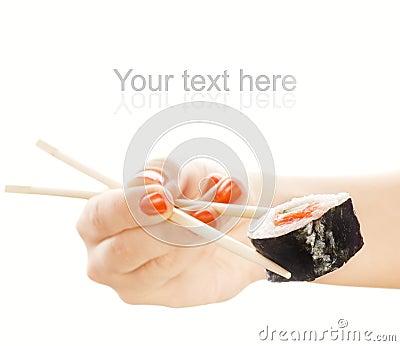 Hand holding sushi maki