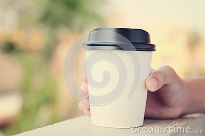 Hand holding take away coffee cup Stock Photo