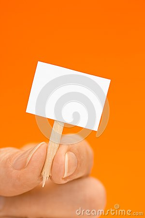 Free Hand Holding Tiny Sign On Orange With Copy Space Stock Photography - 29286922