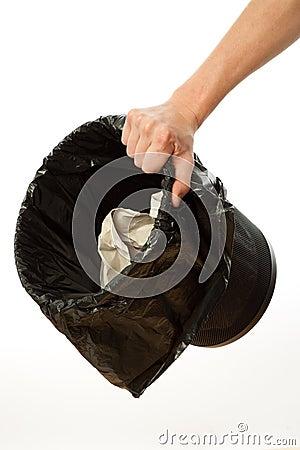 Hand holding trash bin