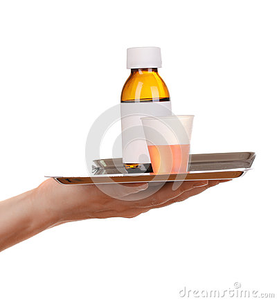 Hand holding tray with medicines