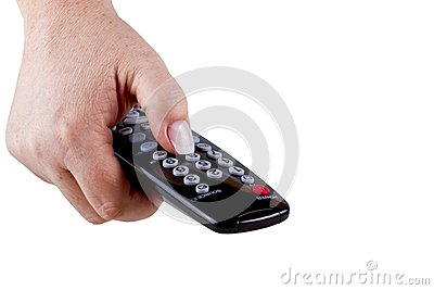 The hand holding a tv remote control