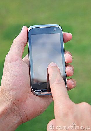 Hand holding and using smart mobile phone