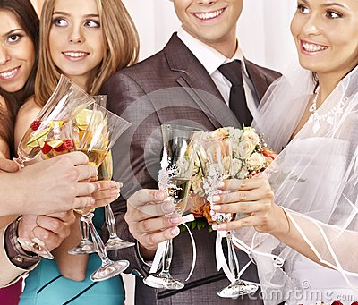 Hand holding wedding glass.