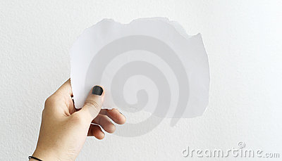 Hand holding a white blank paper