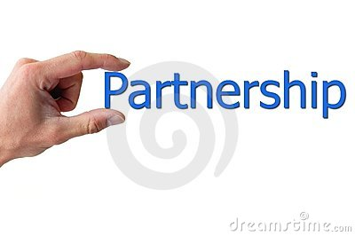 Hand holding the word partnership