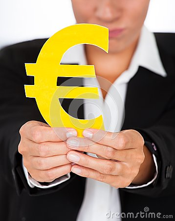 Hand Holding Yellow Euro Sign In Hand