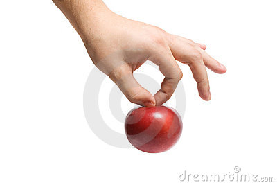The hand holds an apple